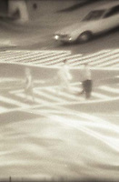 Reflection of people crossing street<br />