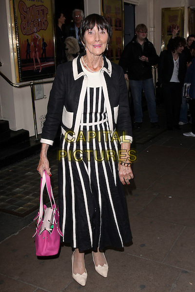 JUNE BROWN.Attending the 'Sweet Charity' Press Night at the Theatre Royal, Haymarket, London, England UK, May 4th 2010. .full length black white striped stripes dress jacket beige shoes pink bag purse .CAP/AH.©Adam Houghton/Capital Pictures.