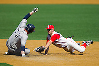 Dan Capeless #11 of the Georgetown Hoyas slides into second base ahead of the tag by Keith Hernandez #10 of the Delaware State Hornets at Gene Hooks Field on February 26, 2011 in Winston-Salem, North Carolina.  Photo by Brian Westerholt / Four Seam Images