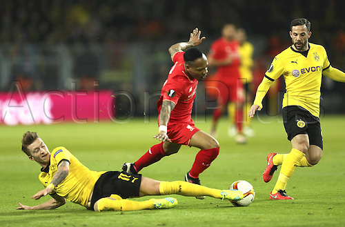 07.04.2016. Dortmund, Germany. Europa League quarterfinal. Borussia Dortmund versus Liverpool FC at the Signal Iduna Park Dortmund. Nathaniel Clyne ( Liverpool ) tackled by Marco Rues
