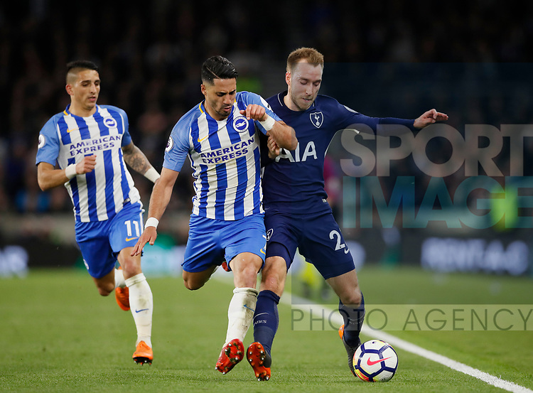 Beram Kayal of Brighton tussles with Christian Eriksen of Tottenham during the premier league match at the Amex Stadium, London. Picture date 17th April 2018. Picture credit should read: David Klein/Sportimage