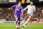 Luka Modric of Real Madrid fights for the ball with Daniel Parejo Munoz of Valencia CF during their La Liga match between Valencia CF and Real Madrid at the Estadio de Mestalla on 22 February 2017 in Valencia, Spain. Photo by Maria Jose Segovia Carmona / Power Sport Images