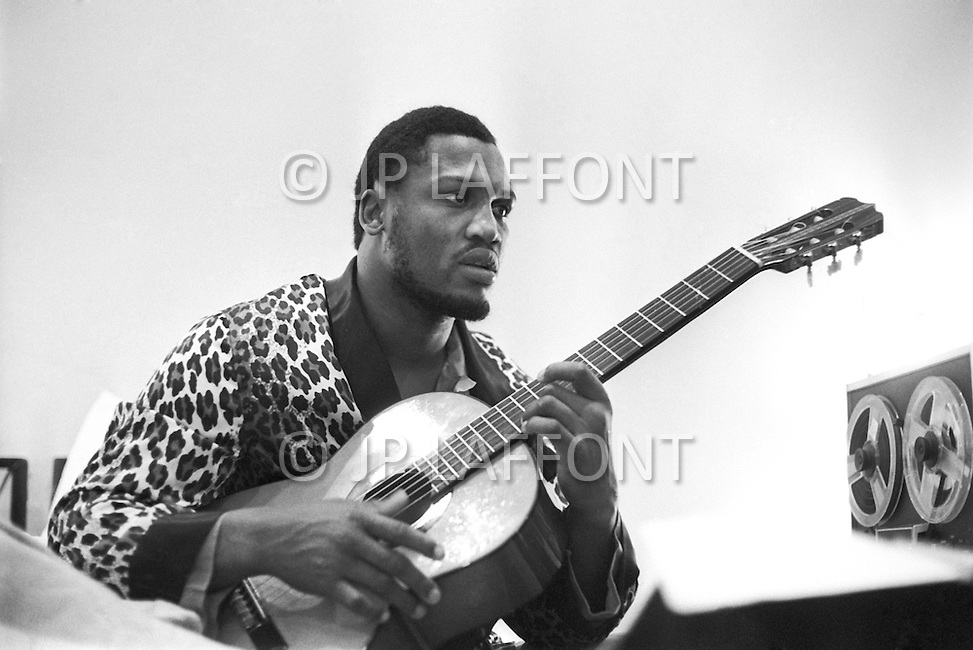 January 1974. American boxer Joe Frazier relaxing playing guitar, at the Concord Hotel in upstate New York.