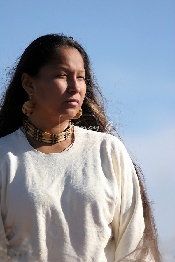 A young Native American Indian Woman looking into the sun on the prairie in South Dakota