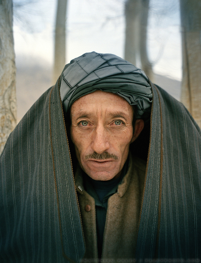 Sardar Khan, protecting himslef from the cold..Family relatives of Pir Shah Ismail in Qala-e Pinja..Winter expedition through the Wakhan Corridor and into the Afghan Pamir mountains, to document the life of the Afghan Kyrgyz tribe. January/February 2008. Afghanistan
