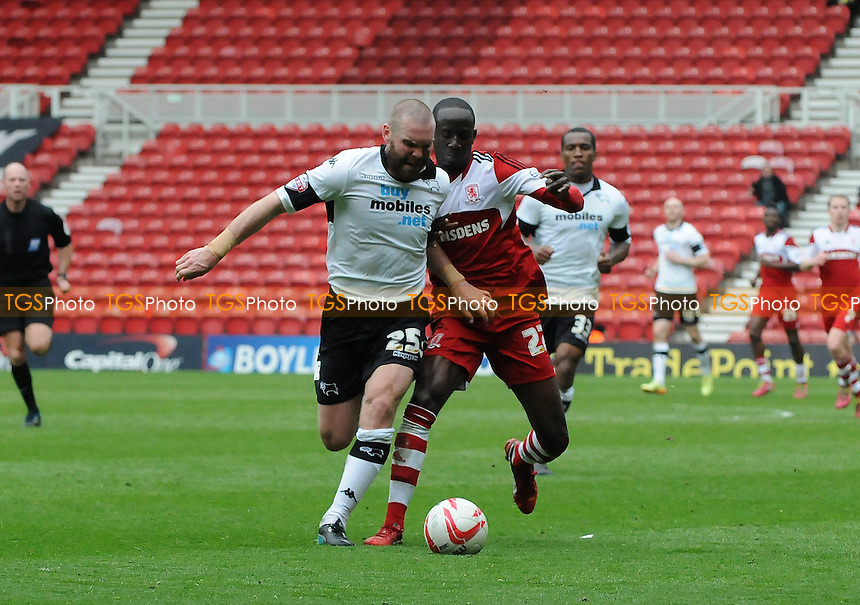 Jake Buxton of Derby County battles with Albert Adomah of Middlesbrough - Middlesbrough vs Derby County - Sky Bet Championship Football at the Riverside Stadium, Middlesbrough - 05/04/14 - MANDATORY CREDIT: Steven White/TGSPHOTO - Self billing applies where appropriate - 0845 094 6026 - contact@tgsphoto.co.uk - NO UNPAID USE