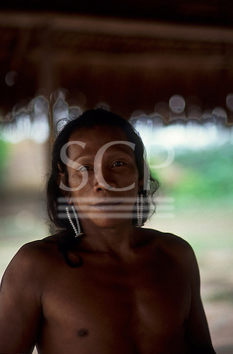 Pikany Village, Brazil. Wakontire, a Kayapo man with white bead earrings; Xingu reserve.