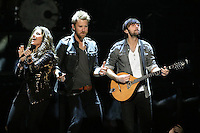 03/27/12 Los Angeles, CA: Hillary Scott, Charles Kelley and Dave Haywood of Lady Antebellum perform at Staples Center during their Own the Night 2012 World Tour