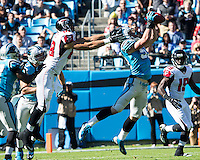 The Carolina Panthers defeated the Atlanta Falcons 34-10 in an inter-division rivalry played in Charlotte, NC at Bank of America Stadium.  Carolina Panthers middle linebacker Luke Kuechly (59) intercepts a ball intended for Atlanta Falcons tight end Tony Gonzalez (88)