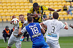 Phoenix's Kenny Cunningham, centre, heads the ball to score against the Perth Glory in the A-League football match at Westpac Stadium, Wellington, New Zealand, Sunday, March 09, 2014. Credit: Dean Pemberton