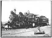 Conventional front 3/4 fireman's-side view of engine and tender.  Engine and train crew are posed on firebox top, running board and on ground.  Hand pump car is in right foreground.<br /> St. Louis, Rocky Mountain &amp; Pacific Ry.  near Cimarron, NM  Taken by Troutman, Edward A.