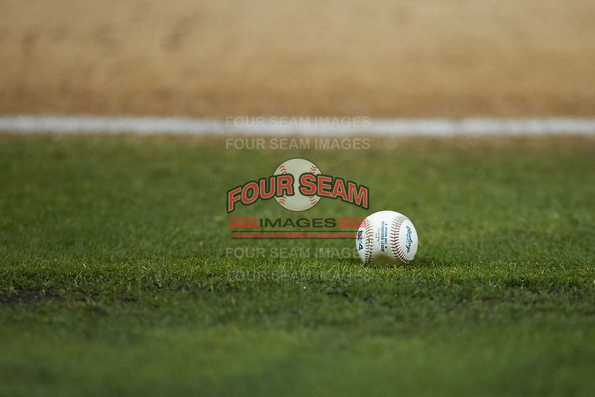 An International League baseball sits on the field during the game between the Gwinnett Braves and the Durham Bulls at Durham Bulls Athletic Park on April 20, 2019 in Durham, North Carolina. The Bulls defeated the Braves 3-2 in game two of a double-header. (Brian Westerholt/Four Seam Images)