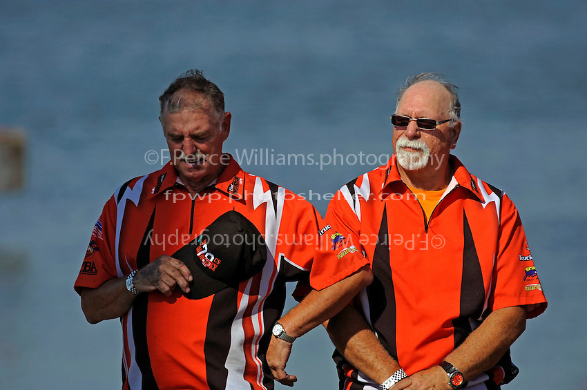 """Crew members for  GP-79 """"Bad Influence""""  pause on the pier for the playing of the National Anthem (Grand Prix Hydroplane(s)"""