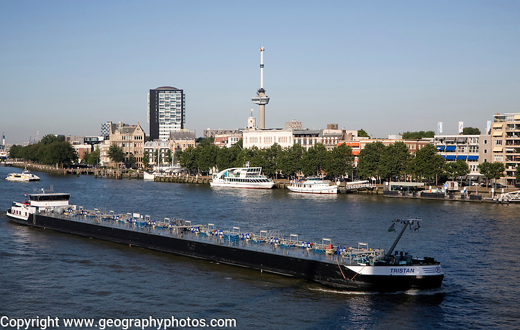 River barge chemical transporter ship 'Tristan' passing Euromast in the city, River Maas, Port of Rotterdam, Netherlands