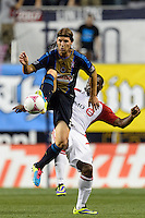 Jeff Parke (31) of the Philadelphia Union under pressure from Bright Dike (7) of Toronto FC. The Philadelphia Union defeated Toronto FC 1-0 during a Major League Soccer (MLS) match at PPL Park in Chester, PA, on October 5, 2013.