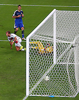 Mario Goetze of Germany wheels away as the ball hits the back of the net for the winning goal