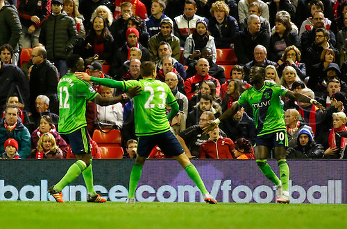 25.10.2015. Anfield, Liverpool, England. Barclays Premier League. Liverpool versus Southampton. Southampton striker Sadio Mané (right) is congratulated by Gastón Ramírez and Victor Wanyama after scoring his late equaliser.