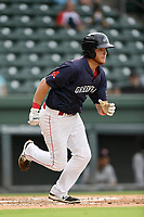 First baseman Garrett Benge (17) of the Greenville Drive runs out a batted ball in Game 1 of a doubleheader against the Hickory Crawdads on Wednesday, July 25, 2018, at Fluor Field at the West End in Greenville, South Carolina. Greenville won, 4-1. (Tom Priddy/Four Seam Images)