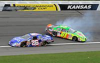 Oct. 3, 2009; Kansas City, KS, USA; NASCAR Nationwide Series driver Kevin Conway (26) goes low as Patrick Sheltra (81) spins during the Kansas Lottery 300 at Kansas Speedway. Mandatory Credit: Mark J. Rebilas-