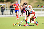 Mannheim, Germany, April 18: During the 1. Bundesliga Damen match between TSV Mannheim (white) and Mannheimer HC (red) on April 18, 2015 at TSV Mannheim in Mannheim, Germany. Final score 1-7 (1-4). (Photo by Dirk Markgraf / www.265-images.com) *** Local caption *** Solveg Althof #40 of Mannheimer HC, Tonja Fabig #31 of TSV Mannheim
