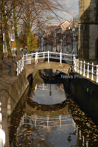 Delft, Netherlands - November 5, 2007 -- Canal near Oude Kerk (Old Church), in Delft, Netherlands on Monday, November 5, 2007.  Delftware, the distinctive Dutch blue and white pottery, is produced in this factory..Credit: Ron Sachs / CNP