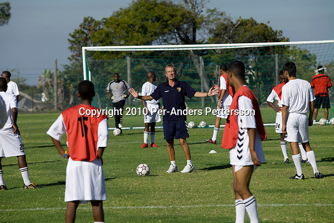 CAPE TOWN, SOUTH AFRICA - APRIL 8: Roald Poulsen, a Danish soccer coach, instructs young and talented soccer players on a field on April 8, 2010, in Cape Town, South Africa. Mr. Poulsen is the technical director for Cape United, a soccer academy for talented players from Africa and abroad. The school aims to develop their soccer skills, life skills and ultimately to place the most talented with professional soccer clubs around the world. The boys are mentored by players from the English Premiership and around 30 players a year are accepted. Cape United is the first African soccer development base for sourcing, developing and placing talent. (Photo by Per-Anders Pettersson/Getty Images)