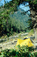 This stock photo shows a camp tent pitched along the bank of the Wild and Scenic Rogue River in Southern Oregon.