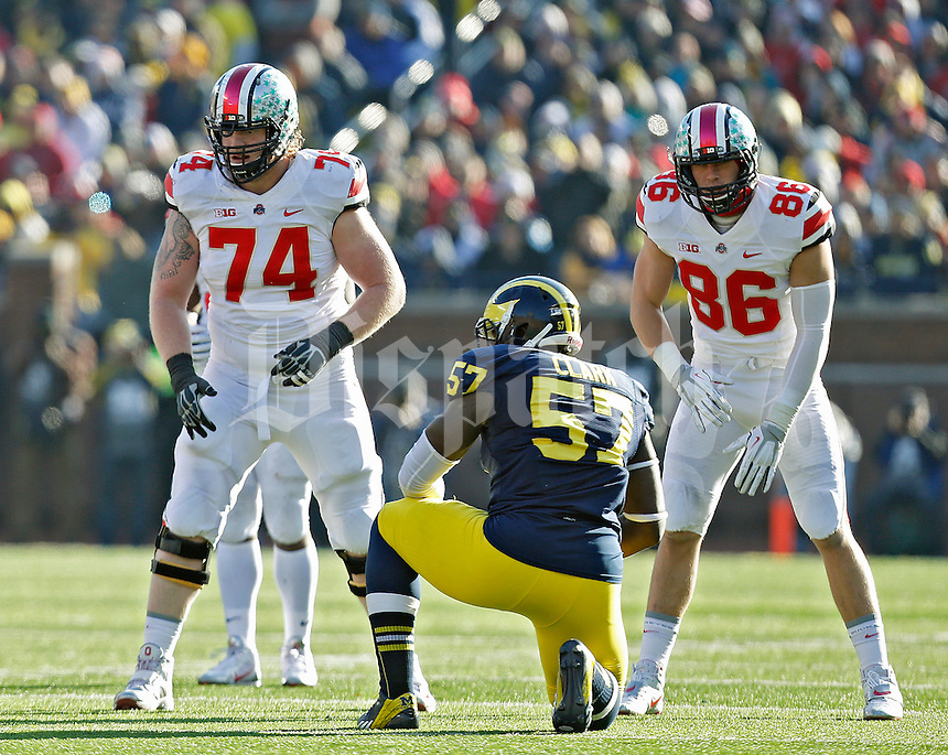 Ohio State Buckeyes offensive linesman Jack Mewhort (74) and Ohio State Buckeyes tight end Jeff Heuerman (86) against Michigan Wolverines during their college football game at Michigan Stadium in Ann Arbor, Michigan on November 30, 2013.  (Dispatch photo by Kyle Robertson)
