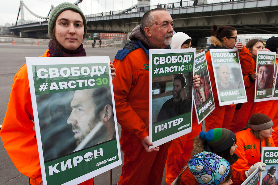Moscow, Russia, 05/10/2013.<br /> A Greenpeace activist holds a portrait of British video journalist Kieron Bryan at a demonstration in support of the crew members of the ship &quot;Arctic Sunrise&quot; . The entire crew and accompanying journalists including Bryan have been charged with piracy after being seized at gunpoint by Russian coastguards while protesting at a Gazprom off-shore drilling platform In the Arctic.