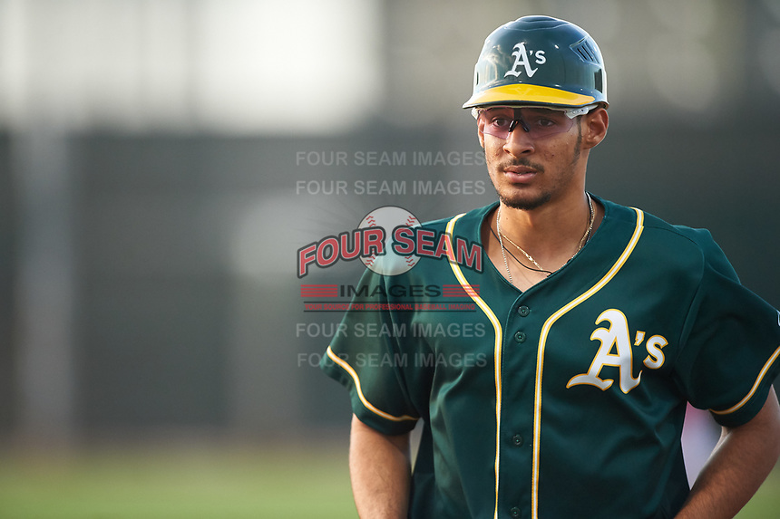 AZL Athletics Green coach Gabriel Ortiz (16) walks toward the dugout between innings of an Arizona League game against the AZL Reds on July 21, 2019 at the Cincinnati Reds Spring Training Complex in Goodyear, Arizona. The AZL Reds defeated the AZL Athletics Green 8-6. (Zachary Lucy/Four Seam Images)