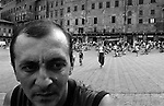Piazza del Campo surrounded by the elegant palazzi in Siena is the focus of town activities, the most popular tourist place. Vitalie is not a tourist; he is a short-term migrant from Romania looking for job, he would work day and night, his  family depends on his earnings.