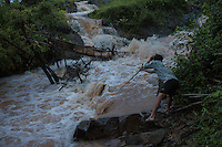 A fisherman with his bamboo net in front of the Liphi Waterfalls. 07/08/2013 © Thomas Cristofoletti / Ruom