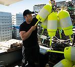 Maine lobsterman Cody Lyon prepares his buoys.