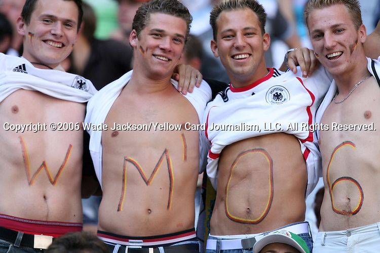 "14 June 2006: Four Germany fans with ""WM'06"" on their chests. Tunisia and Saudi Arabia tied 2-2 at the Allianz Arena in Munich, Germany in match 16, a Group H first round game, of the 2006 FIFA World Cup."