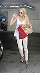 8-10-09..Lindsay Lohan leaving her house eating a cup of spaghetti so she could smoke cigarettes inside her car with the windows rolled up. Lindsay had her assistant drive to a store called Satine in Hollywood to pick up 10 dresses. ...ABILITYFILMS@yahoo.com.805-427-3519.www.Abilityfilms.com.