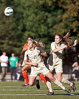 Boston College midfielder Kate McCarthy (21) heads the ball. .After two overtime periods, Boston College (gold) tied University of Miami (orange), 0-0, at Newton Campus Field, October 21, 2012.