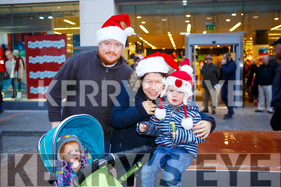 Waiting for Santa at CH Chemist Christmas Parade Tralee on Saturday were Conor, Ciara, Kevin, Aibhlinn O'Reilly