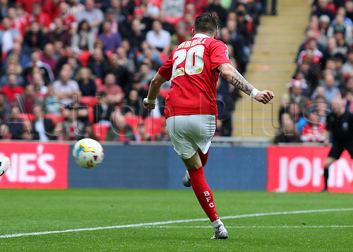 03.04.2016. Wembley Stadium,  London, England. Johnstones Paint Trophy Football Final Barnsley versus  Oxford Utd. Barnsley's Adam Hammill strikes and scores for Barnsley  to put Barnsley up 3-1 in the 74th minute