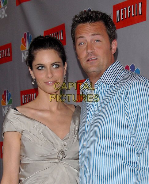 AMANDA PEET & MATTHEW PERRY.Attend The NBC All Star Party held at The Ritz Carlton Pasadena Huntington Hotel in Pasadena, California, USA,.July 22 2006..half length blue and white striped shirt grey beige dress.Ref: DVS.www.capitalpictures.com.sales@capitalpictures.com.©Debbie VanStory/Capital Pictures