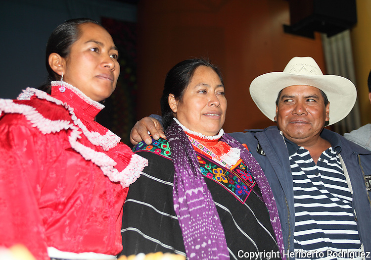 Native Ñah Ñuh Mexican Jacinta Francisco Marcial (C) is hugged by her husband Guillermo Francisco Prisciliano and her daughter Estela Hernandez after being released from prison, September 17, 2009. Jacinta Francisco Marcial was charged by kidnapping six Federal policemen during a police raid in her Santiago Mexquititlan town market on August 2006. Photo by Heriberto Rodriguez
