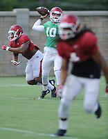 NWA Democrat-Gazette/ANDY SHUPE<br /> Arkansas quarterback Brandon Allen passes Tuesday, Aug. 11, 2015, during practice at the university's practice field in Fayetteville.
