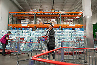Shoppers take advantage of the supply of paper towels available at the Costco Wholesale store in Arlington, Va., Monday, March16, 2020. With the supply of toilet paper in steep demand and low supply during the COVID-19 pandemic, people are resorting to paper towels and napkins as a substitute. Credit: Rod Lamkey / CNP/AdMedia