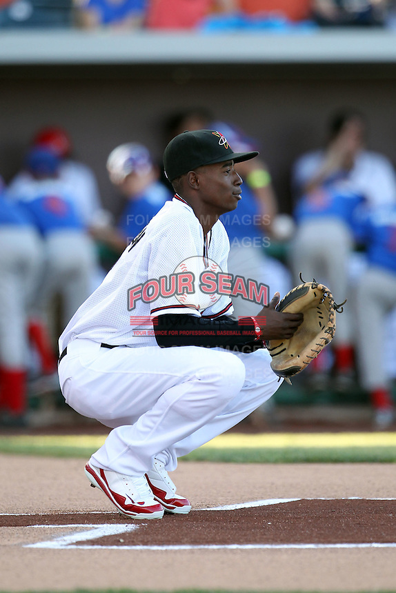 Dee Gordon #5 of the Albuquerque Isotopes catches the opening pitch before a Pacific Coast League game against the Omaha Storm Chasers at Isotopes Park on May 4, 2011  in Albuquerque, New Mexico. .Photo by:  Bill Mitchell/Four Seam Images.