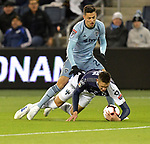 Daniel Salloi of Sporting KC (top) vies for the ball with Cesar Montes of C.F Monterrey during their CONCACAF Champions League semifinal soccer game on April 11, 2019 at Children's Mercy Park in Kansas City, Kansas.  Photo by TIM VIZER/AFP