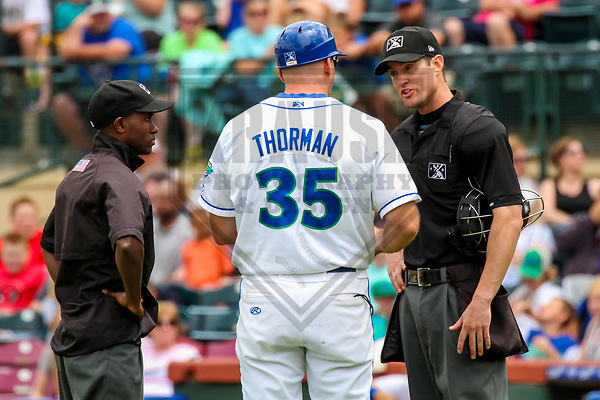 Umpires Darrell Roberts (left) and Mark Bass (right) and Lexington Legends manager Scott Thorman (35) during a South Atlantic League game between the Lexington Legends and the Columbia Fireflies on May 28, 2017 at Whitaker Bank Ballpark in Lexington, Kentucky.  Columbia defeated Lexington 3-0. (Brad Krause/Krause Sports Photography)