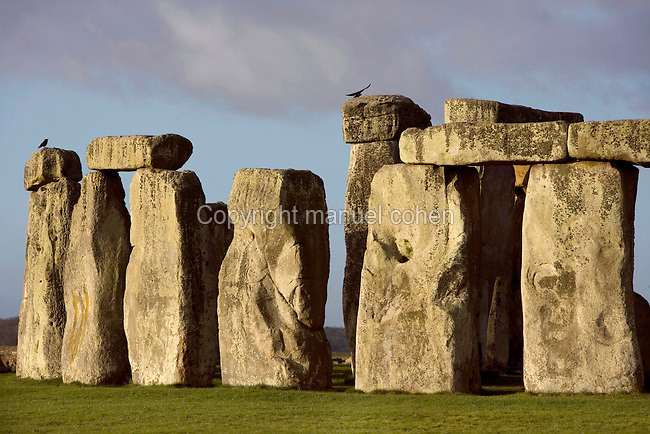 Circle of Sarsen stones with lintels, surrounding a Horseshoe of Sarsen Trilithons, Stonehenge, Neolithic and Bronze Age megalithic monument, 3050 - 1500 BC, Salisbury, Wiltshire, England, UK. Picture by Manuel Cohen