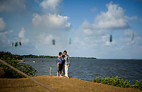 Spanish tourists enjoy a moment together in the small grassy community of Marshall Point near the top of Pearl Lagoon in Nicaragua in April, 2009.