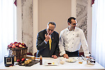 Sen. Charles Schumer, left, and executive chef Shannon Shaffer prepare Hudson Valley apple pie, sour cream ice cream, aged cheese and honey, which will be served for the inaugural lunch, on Friday, January 4, 2013 in Washington, DC.