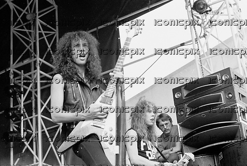 METALLICA - Kirk Hammett and James Hetfield - performing live at The Sportsfield in Poperinge Belgium - 10 June 1984.  Photo credit: PG Brunelli/IconicPix