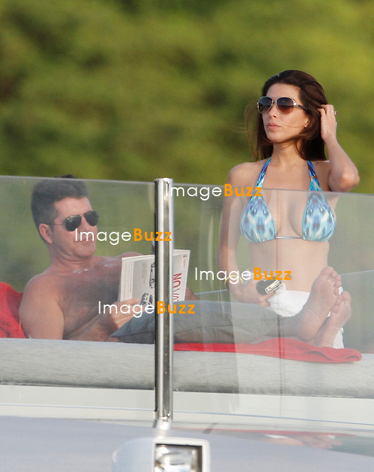 SIMON COWELL CONTINUES HIS VACATION IN ST. BARTHS WITH HIS FORMER FIANCEE - January 6, 2013-St.Barts (FR)-Simon Cowell wears a nicotine patch on his left arm as he is a jet skiing while on vacation with former flame Mezhgan Hussainy aboard his yacht in the Caribbean.